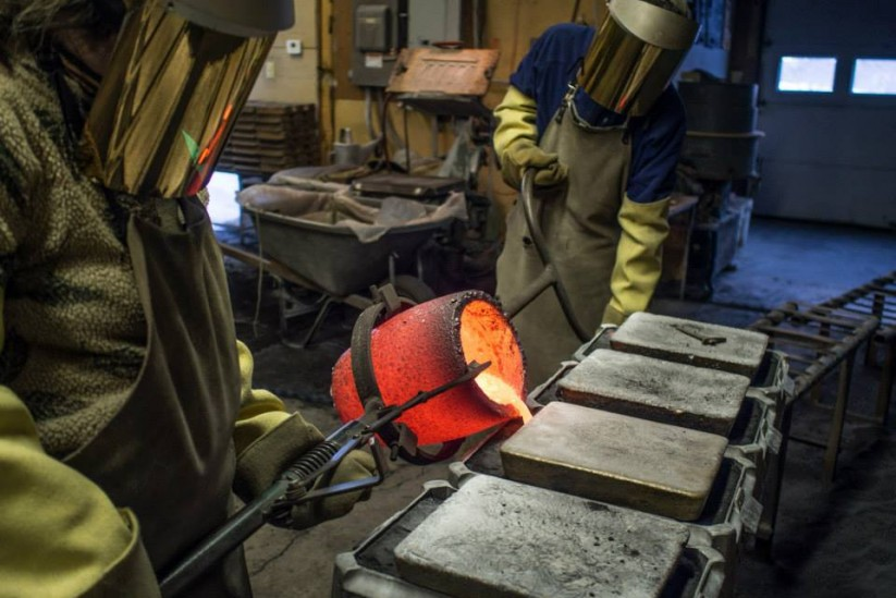 Dan and Maggi pouring bronze into sand molds